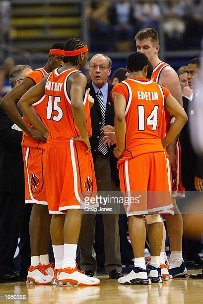 Head coach Jim Boeheim of Syracuse gives instructions in the huddle during a timeout against Kansas during the championship game of the NCAA Men's...