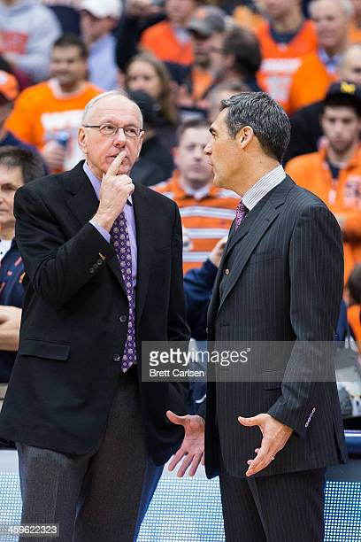 head coach Jim Boeheim of the Syracuse Orange and head coach Jay Wright of the Villanova Wildcats talk before facing each other in a basketball game...