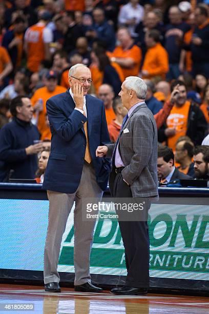 head coach Jim Boeheim of the Syracuse Orange and head coach Roy Williams of the North Carolina Tar Heels speak before a basketball game between the...
