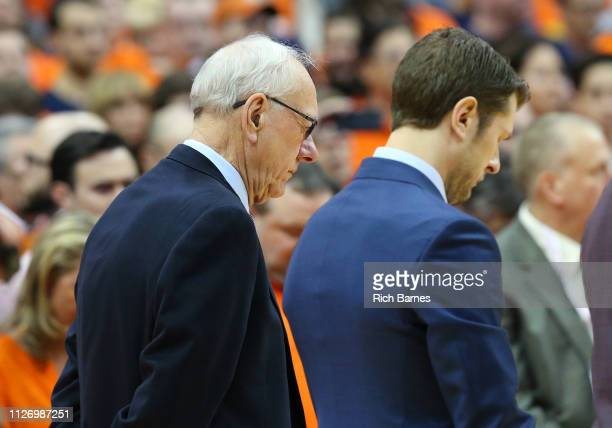 Head coach Jim Boeheim of the Syracuse Orange bows his head during a moment of silence for Jorge Jimenez the 51yearold man who was killed on a local...