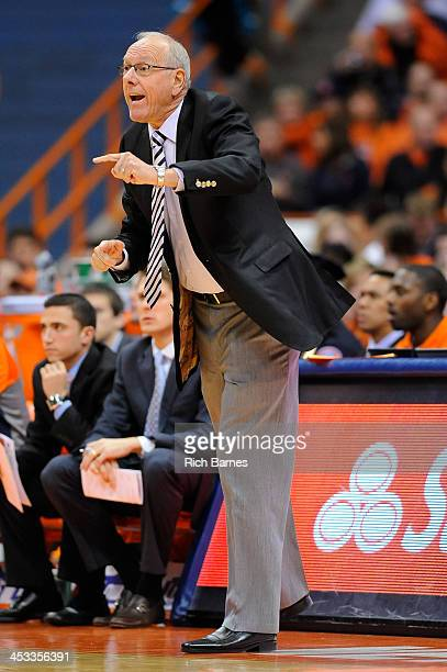 Head coach Jim Boeheim of the Syracuse Orange calls a play for his team against the Indiana Hoosiers during the first half at the Carrier Dome on...