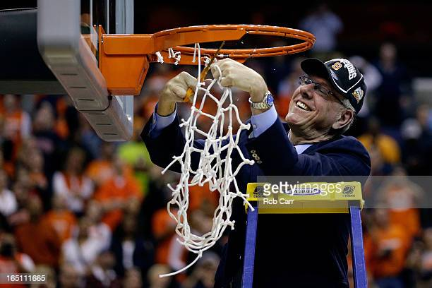 Head coach Jim Boeheim of the Syracuse Orange cuts down the net after defeating the Marquette Golden Eagles to win the East Regional Round Final of...
