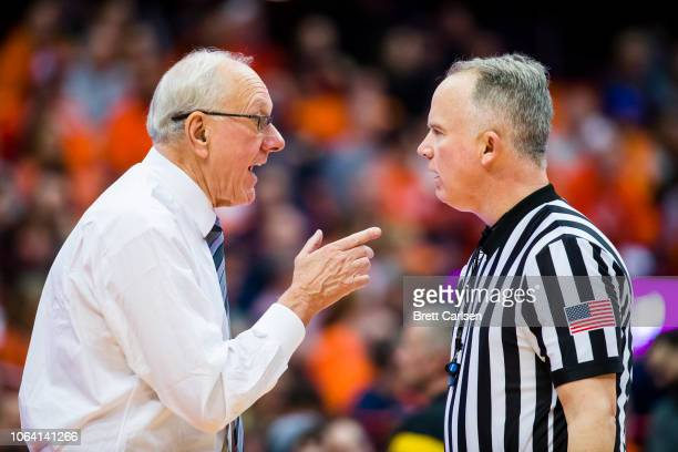 Head coach Jim Boeheim of the Syracuse Orange discusses a call with a referee during the second half against the Colgate Raiders at the Carrier Dome...