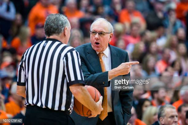 Head coach Jim Boeheim of the Syracuse Orange disputes a call with a referee during the second half against the Georgetown Hoyas at the Carrier Dome...