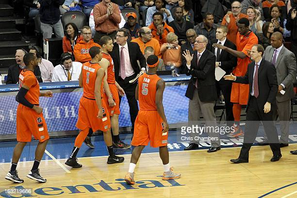Head coach Jim Boeheim of the Syracuse Orange greets his players during a timeout against the Seton Hall Pirates at Prudential Center on February 16...