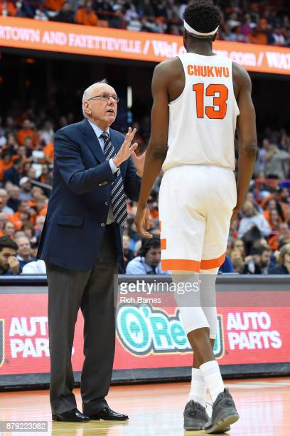 Head coach Jim Boeheim of the Syracuse Orange reacts to a play while talking with Paschal Chukwu against the Toledo Rockets during the second half at...