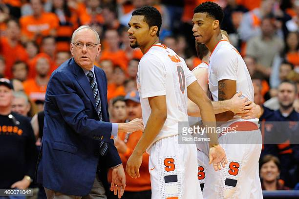 Head coach Jim Boeheim of the Syracuse Orange restrains Michael Gbinije and Chris McCullough during an altercation against the St John's Red Storm...
