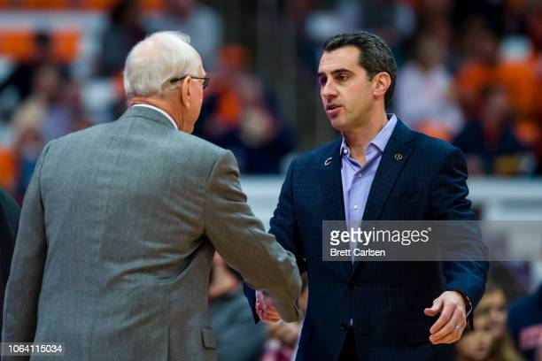 Head coach Jim Boeheim of the Syracuse Orange shakes hands with head coach Matt Langel of the Colgate Raiders before the game at the Carrier Dome on...