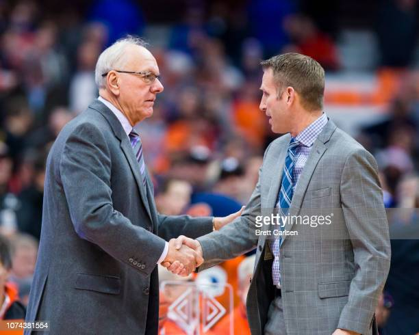 Head coach Jim Boeheim of the Syracuse Orange shakes hands with Head coach Nate Oats of the Buffalo Bulls before the game at the Carrier Dome on...