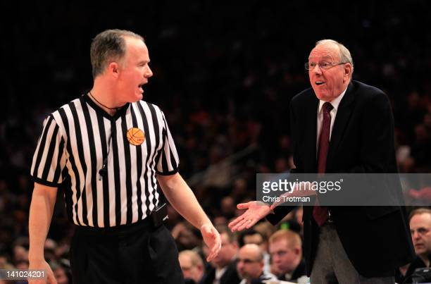 Head coach Jim Boeheim of the Syracuse Orange speaks to an official during the second half against the Cincinnati Bearcats during the semifinals of...