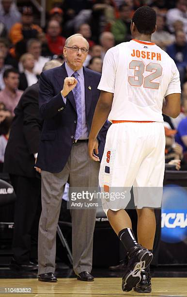 Head coach Jim Boeheim of the Syracuse Orange speaks to Kris Joseph of the Syracuse Orange during the game against the Indiana State Sycamores during...