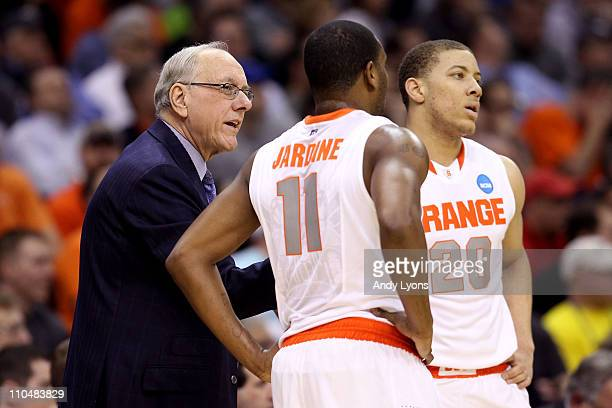 Head coach Jim Boeheim of the Syracuse Orange speaks to Scoop Jardine and Brandon Triche during the game against the Indiana State Sycamores during...