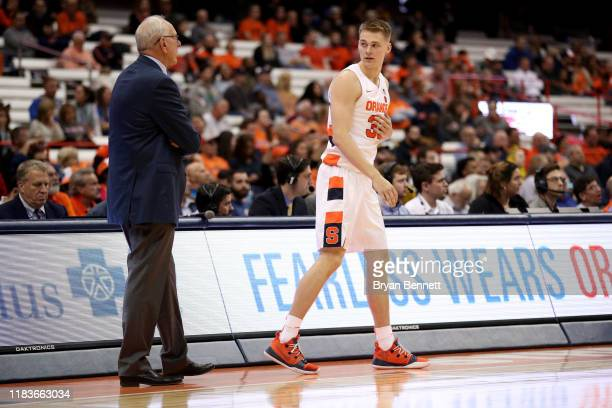 Head Coach Jim Boeheim of the Syracuse Orange speaks with his son Buddy Boeheim of the Syracuse Orange during the second half of an exhibition game...