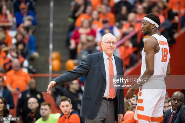 Head coach Jim Boeheim of the Syracuse Orange speaks with Paschal Chukwu during the first half against the Colgate Raiders at the Carrier Dome on...