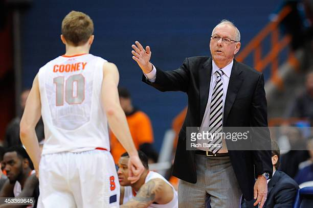 Head coach Jim Boeheim of the Syracuse Orange speaks with Trevor Cooney against the Indiana Hoosiers during the second half at the Carrier Dome on...