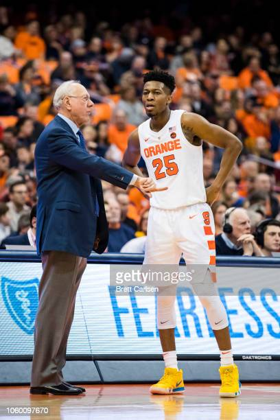 Head coach Jim Boeheim of the Syracuse Orange speaks with Tyus Battle during the second half against the Morehead State Eagles at the Carrier Dome on...