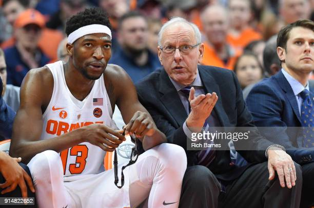 Head coach Jim Boeheim of the Syracuse Orange talks to Paschal Chukwu on the bench against the Virginia Cavaliers during the second half at the...
