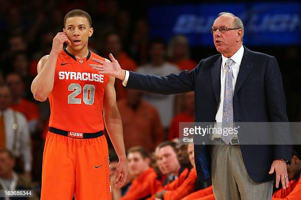 Head coach Jim Boeheim of the Syracuse Orange talks with Brandon Triche against the Pittsburgh Panthers during the quaterfinals of the Big East Men's...