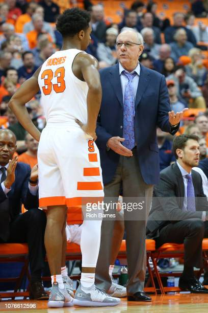 Head coach Jim Boeheim of the Syracuse Orange talks with Elijah Hughes against the Cornell Big Red during the second half at the Carrier Dome on...