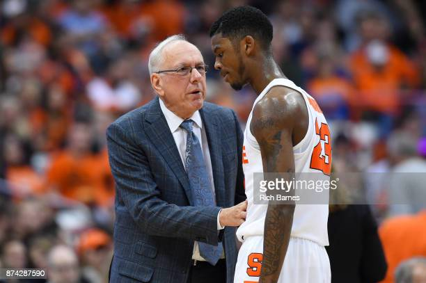 Head coach Jim Boeheim of the Syracuse Orange talks with Frank Howard against the Iona Gaels during the second half at the Carrier Dome on November...