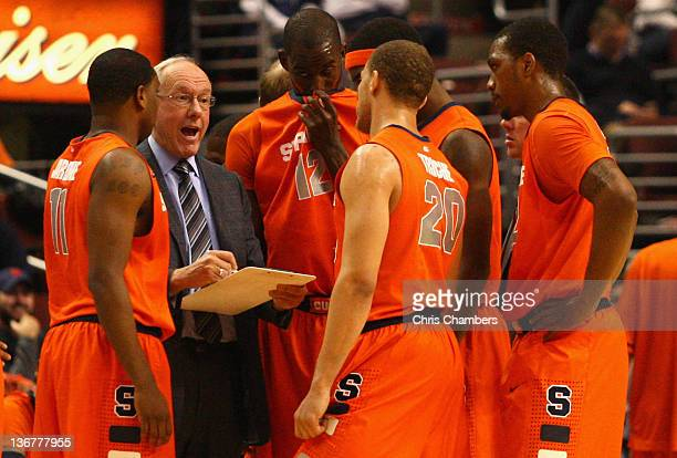 Head coach Jim Boeheim of the Syracuse Orange talks with his players during a timeout against the Villanova Wildcats at the Wells Fargo Center on...