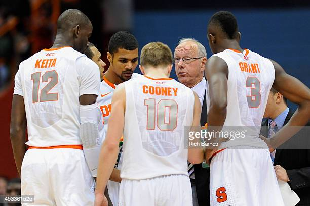 Head coach Jim Boeheim of the Syracuse Orange talks with his team during a time out in the second half against the Indiana Hoosiers at the Carrier...