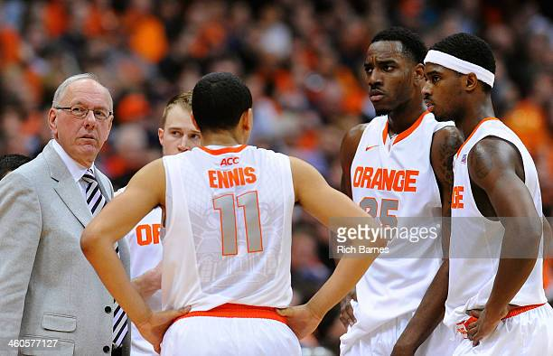Head coach Jim Boeheim of the Syracuse Orange talks with his team during a time out against the Miami Hurricanes in the second half at the Carrier...