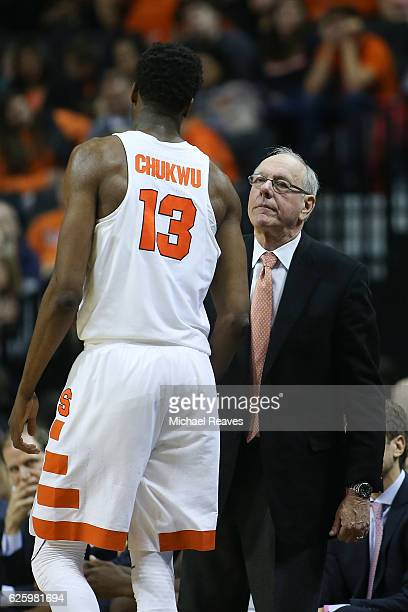 Head coach Jim Boeheim of the Syracuse Orange talks with Paschal Chukwu against the South Carolina Gamecocks in the second half during the Brooklyn...