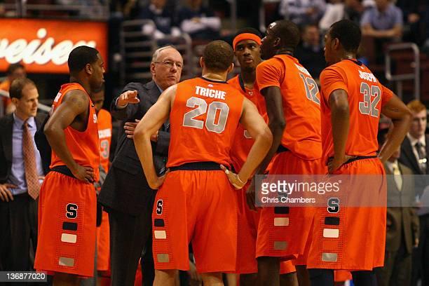 Head coach Jim Boeheim of the Syracuse Orange talks with Scoop Jardine Brandon Triche CJ Fair Baye Moussa Keita and Kris Joseph during a timeout...