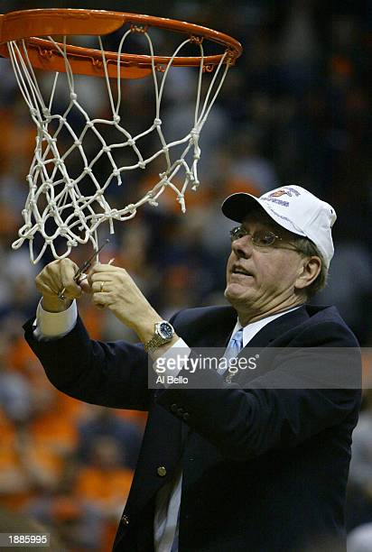 Head coach Jim Boeheim of the Syracuse Orangemen cuts down the net after defeating the Oklahoma Sooners 6347 during the East Regionals of the NCAA...