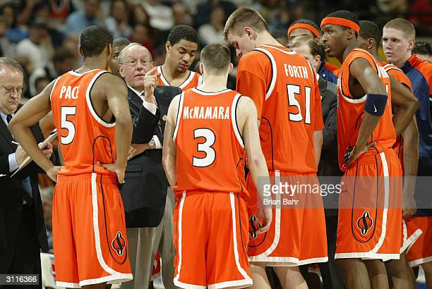Head coach Jim Boeheim of the Syracuse Orangemen talks to his men against the Maryland Terrapins during their second round game of the NCAA Division...