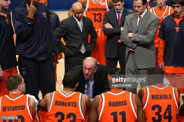 Head coach Jim Boeheim of the Syracuse University Orange speaks with players on the bench against the St. John's University Red Storm at Madison...