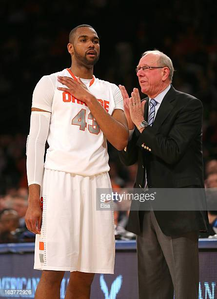 Head coach Jim Boeheim speaks to James Southerland of the Syracuse Orange on the sideline against the Seton Hall Pirates during the second round of...
