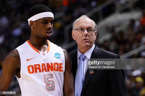 Head coach Jim Boeheim talks to CJ Fair of the Syracuse Orange in the first half against the California Golden Bears during the third round of the...