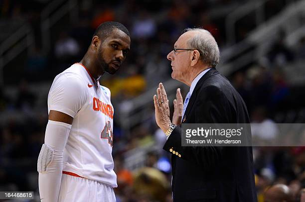 Head coach Jim Boeheim talks to James Southerland of the Syracuse Orange late in the second half against the California Golden Bears during the third...
