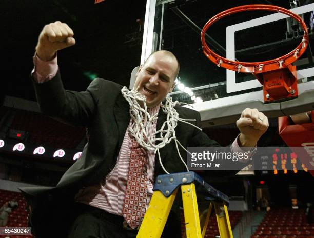 Head coach Jim Boylen of the Utah Utes reacts after cutting down the net after defeating the San Diego State Aztecs 52-50 during the championship...