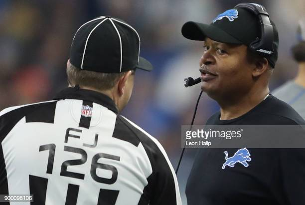 Head coach Jim Caldwell of the Detroit Lion talks with referee Brad Allen during the first quarter against the Green Bay Packers at Ford Field on...