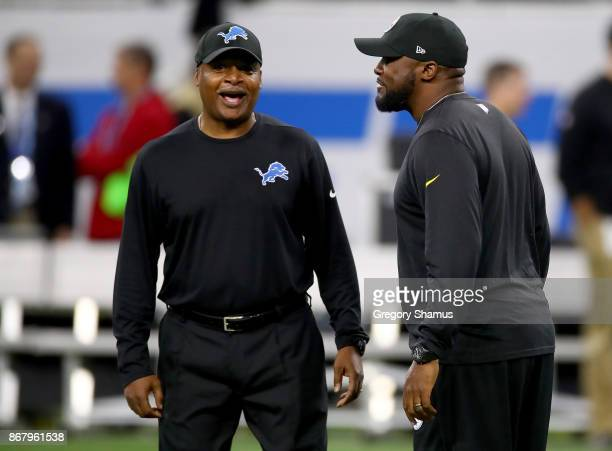 Head coach Jim Caldwell of the Detroit Lions and head coach Mike Tomlin of the Pittsburgh Steelers talk prior to the start of the game at Ford Field...