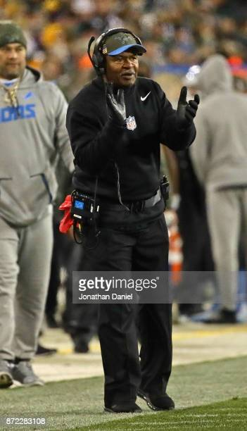 Head coach Jim Caldwell of the Detroit Lions encourages his team against the Green Bay Packers at Lambeau Field on September 28, 2017 in Green Bay,...
