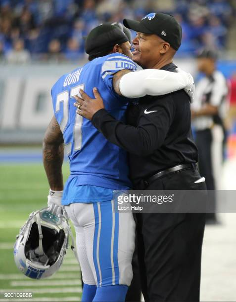 Head coach Jim Caldwell of the Detroit Lions gets a hug from Glover Quin of the Detroit Lions at the end of the game against the Green Bay Packersat...