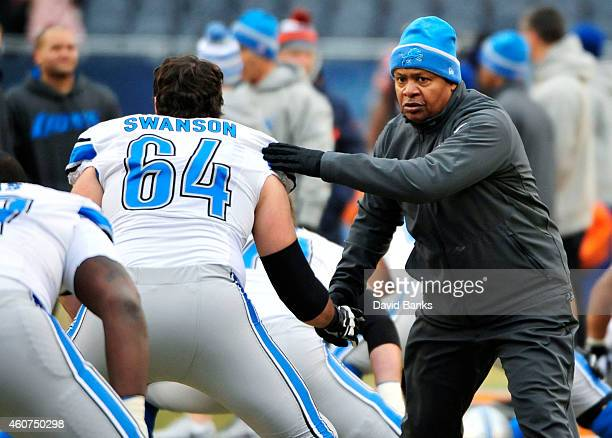 Head coach Jim Caldwell of the Detroit Lions greets Travis Swanson before their game against the Chicago Bears at Soldier Field on December 21, 2014...