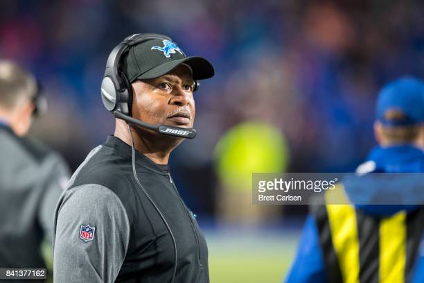 Head coach Jim Caldwell of the Detroit Lions looks to the scoreboard from the sideline during the second half against the Buffalo Bills on August 31...