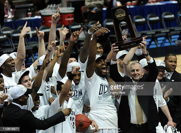 Head coach Jim Calhoun and the Connecticut Huskies celebrate after defeatng the Arizona Wildcats to win the west regional final of the 2011 NCAA...