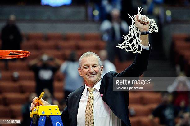 Head coach Jim Calhoun of the Connecticut Huskies cuts down the net after defeatng the Arizona Wildcats to win the west regional final of the 2011...