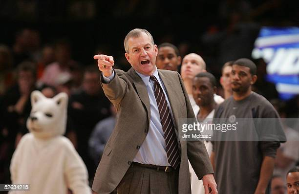 Head coach Jim Calhoun of the Connecticut Huskies points from the sidelines during a game of the Syracuse Orangemen during the semifinal round of the...