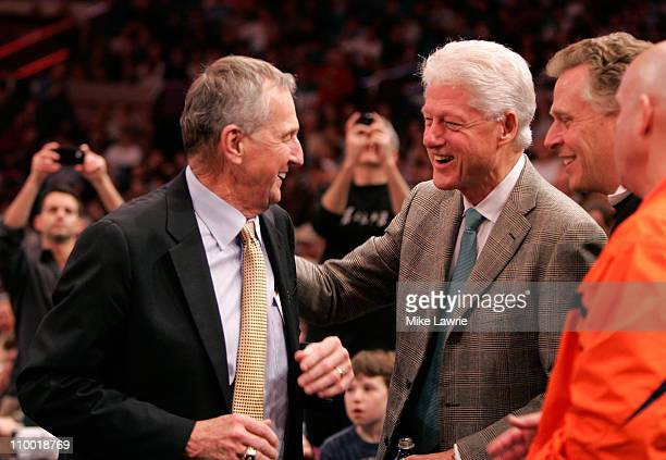 Head coach Jim Calhoun of the Connecticut Huskies speaks with former President Bill Clinton during the semifinals of the 2011 Big East Men's...