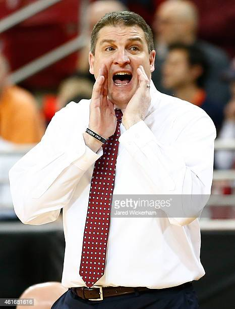 Head coach Jim Christian of the Boston College Eagles yells to his team in the first half against the Virginia Cavaliers during the game at Conte...