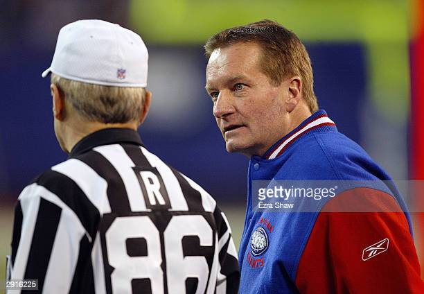 Head coach Jim Fassel of the New York Giants talks with referee Bernie Kukar during the game against the Carolina Panthers on December 28 2003 at...