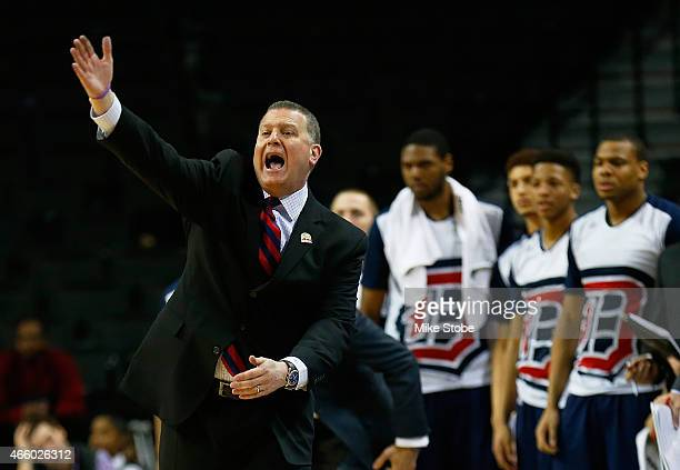 Head coach Jim Ferry of the Duquesne Dukes reacts during action against the George Washington Colonials during the Second Round of the Atlantic 10...