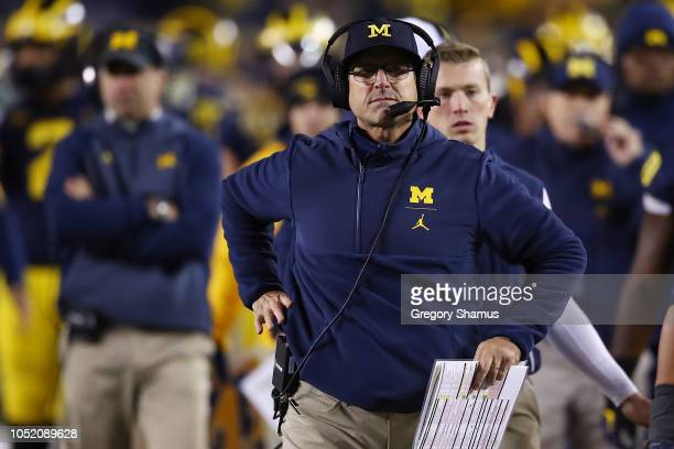 Head coach Jim Harbaugh look on while playing the Wisconsin Badgers on October 13 2018 at Michigan Stadium in Ann Arbor Michigan Michigan won the...